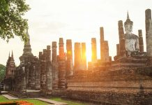 Buddha sculpture and temple ruins in Sukhothai historical park,
